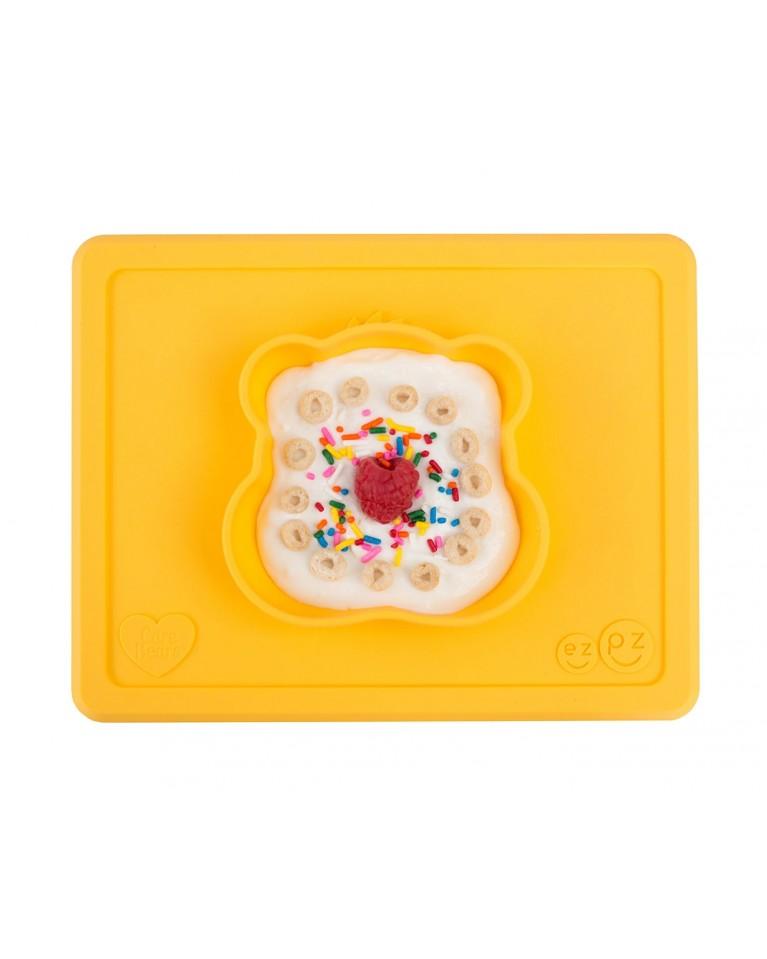 EZPZ silikonowa miseczka z podkładką 2w1 Care Bears™ Bowl Misia Słoneczne Serce Funshine Bear żółta
